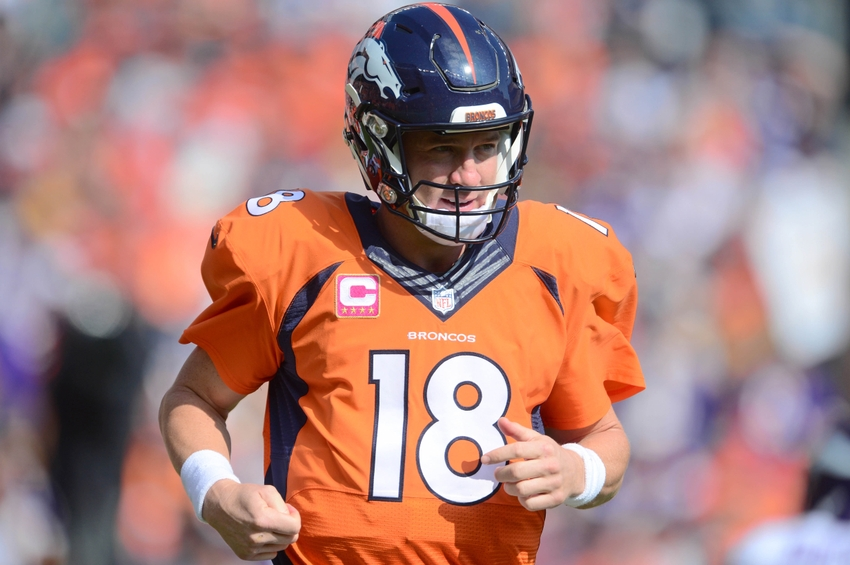 Oct 4, 2015; Denver, CO, USA; Denver Broncos quarterback Peyton Manning (18) in the first quarter against the Minnesota Vikings at Sports Authority Field at Mile High. Mandatory Credit: Ron Chenoy-USA TODAY Sports