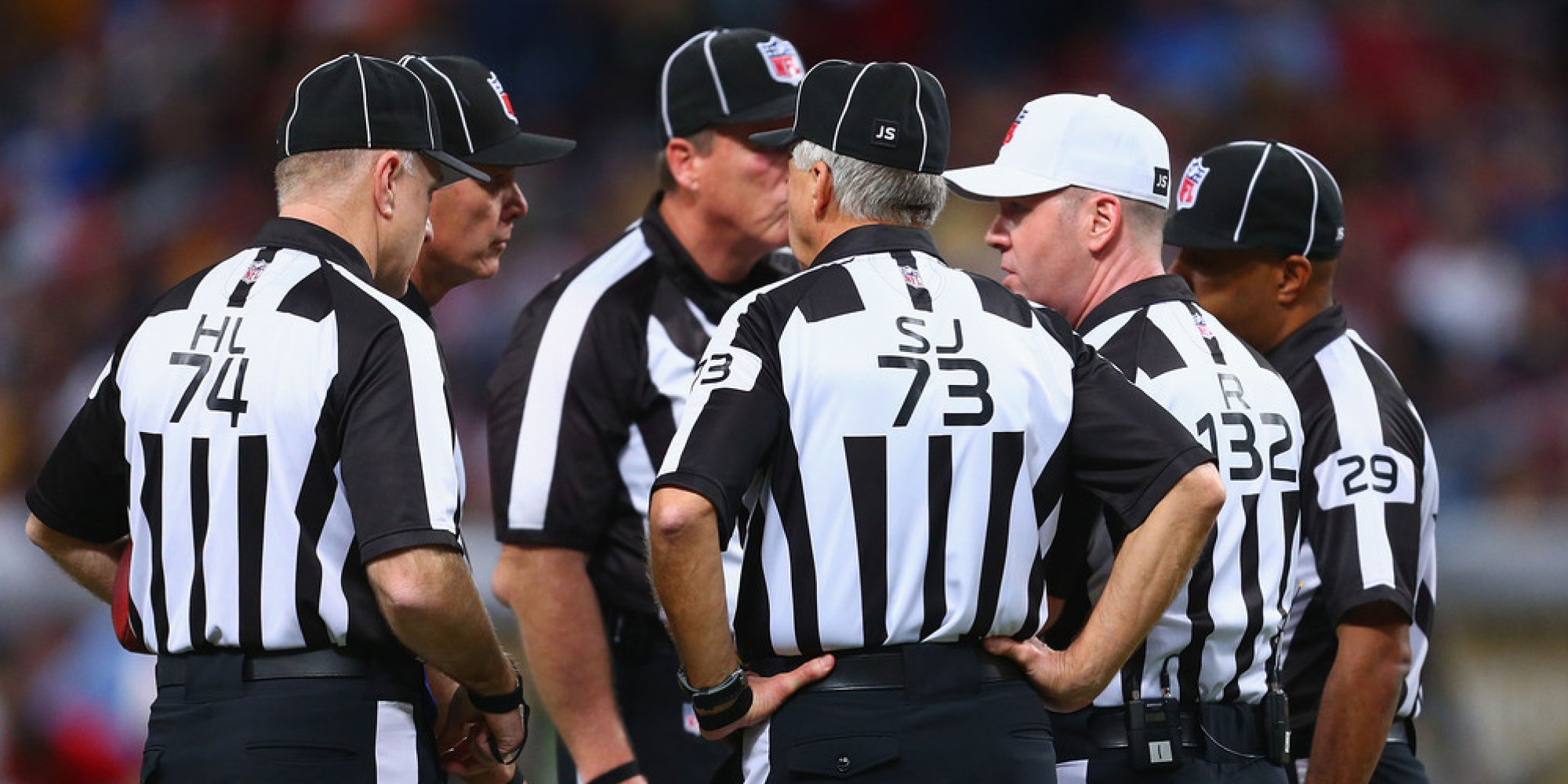 ST. LOUIS, MO - DECEMBER 22: Referee John Parry #132 holds a meeting with other officials during a game between the St. Louis Rams and the Tampa Bay Buccaneers at the Edward Jones Dome on December 22, 2013 in St. Louis, Missouri.  The Rams beat the Buccaneers 23-13.  (Photo by Dilip Vishwanat/Getty Images)