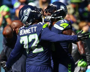 Seahawks defensive lineman Michael Bennett and Seahawks safety Kam Chancellor bump chests before the game against the Bears at CenturyLink Field Sunday, Sept. 27, 2015.